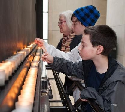 Lighting candles in remembrance at the United States Holocaust Memorial Museum, Washington DC, during Days of Remembrance, 2014.